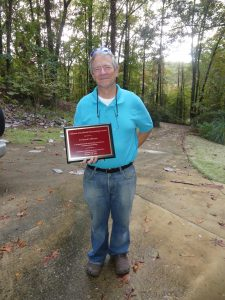 Prescott Atkinson with award